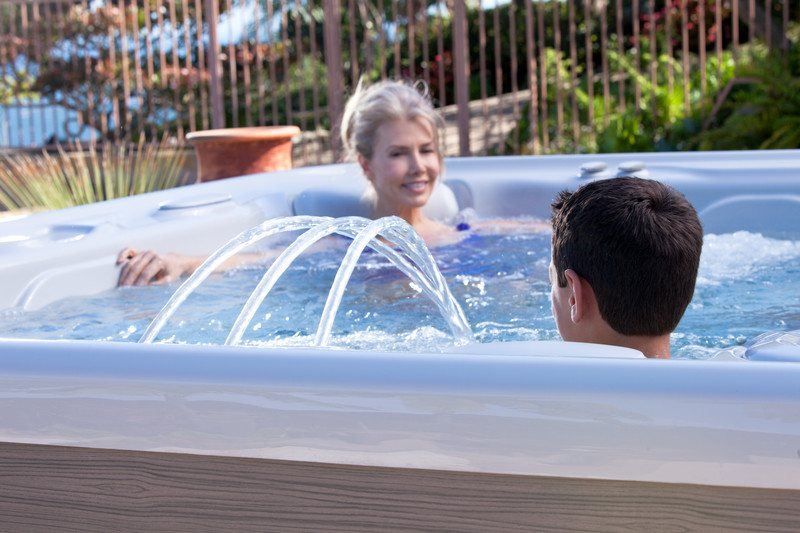 The Highlife Grandee NXT water feature enhances family soak time