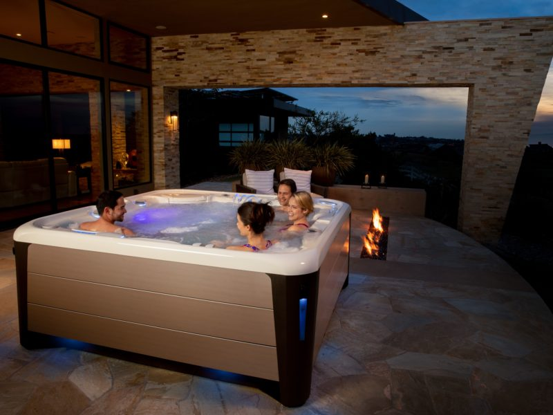 A hot tub enclosure can be a simple roof over your spa or an exterior room that allows you to use your hot tub in even the worst weather.