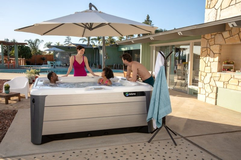 For shade and portability, a spa side umbrella is better than temporary hot tub enclosures.